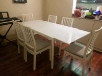 Expandable white dining table with 6 chairs  Watertown, 02472
