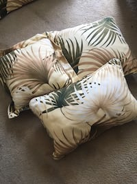 Slipcovered ottoman and matching pillows.