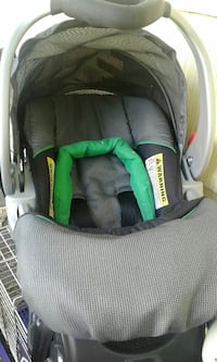 gray and black car seat carrier