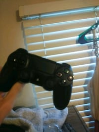 black Sony PS4 console with controller Bakersfield, 93308