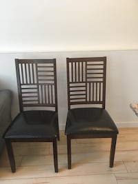Two black leather padded chairs Parksville, V9P 1J7