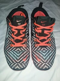 pair of black-and-red Nike running shoes Vancouver, V6H 2N9