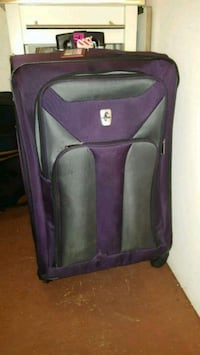 purple and black luggage bag Brandywine, 20613