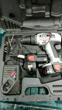 gray and black cordless hand drill set