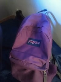 purple and black Jansport backpack Laval, H7A 3R5
