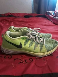 pair of green-and-white Nike running shoes El Paso, 79938