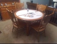 Oak with white tile table top, has 1 leaf & 4 chairs.  Will throw in matching placemats & napkins. Kingsport, 37660