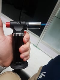 black and stainless steel blow torch