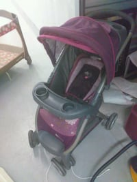 baby's pink and black stroller Thousand Palms, 92276