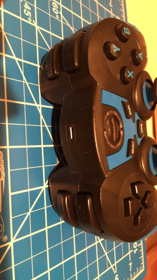 Black and Blue Bluetooth wireless gaming controller d0466dcf-c0b9-4a0f-aa3c-f57fde646fac