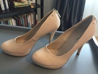 pair of beige leather platform stiletto shoes Vancouver