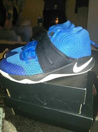 pair of blue-and-black Nike Kyrie Ivring 3's with box