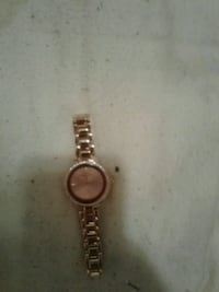 round gold analog watch with link bracelet London, N5Y 3X8
