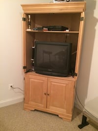 Brown wooden tv armoire hutch with crt television