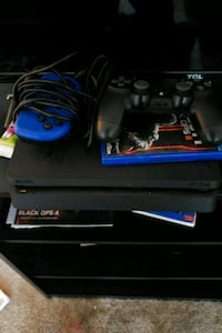 PS4 W/ 2 controllers And Games Dover, 19904
