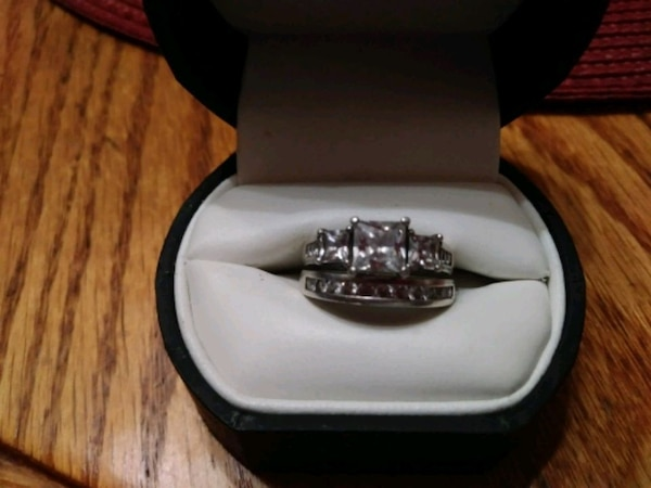 silver and diamond ring in box