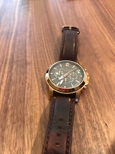 round black Fossil chronograph watch with brown leather band