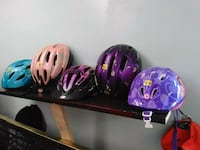 three purple and black bicycle helmets Baltimore, 21223