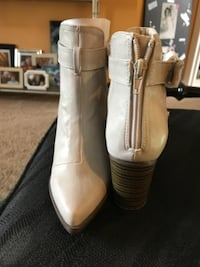 pair of white leather boots PROSPECTHEIGHTS