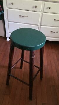 brown and green wooden stool