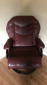 Brown leather padded rolling armchair.