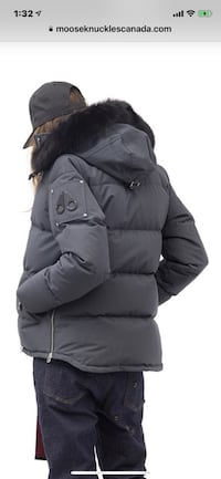 black and gray zip-up bubble jacket 551 km