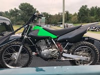 green and black Kawasaki motocross dirt bike 31 km