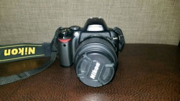 Black Nikon D40 DSLR With Lens Camera