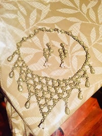 Silver necklace and earrings set with white stones  Laval, H7X 3T2