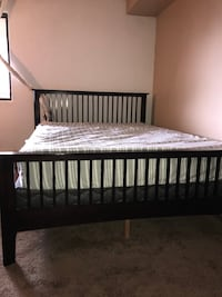 brown wooden bed frame with white mattress Edmonton, T5H 1S4