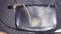 black leather crossbody bag with gold-colored chain link sling Oxnard, 93033