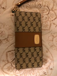 Tan and Brown original wristlet a little used good condition.   Long Beach, 90815