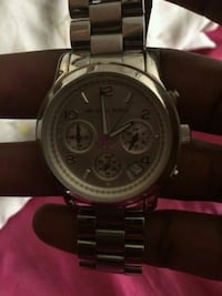 round silver chronograph watch with link bracelet West Hollywood, 90048
