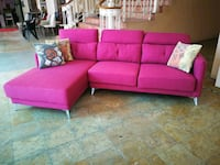 pink fabric sectional sofa with throw pillows