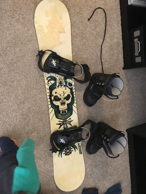 Black and white snowboard and boots