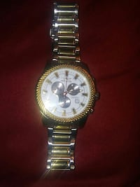 Round gold-colored invicta chronograph watch with gold link band