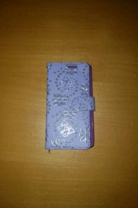 Purple phone case that holds your ID and cards
