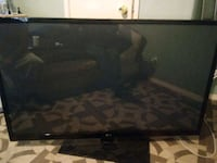 black flat screen TV with remote Riverside, 92515