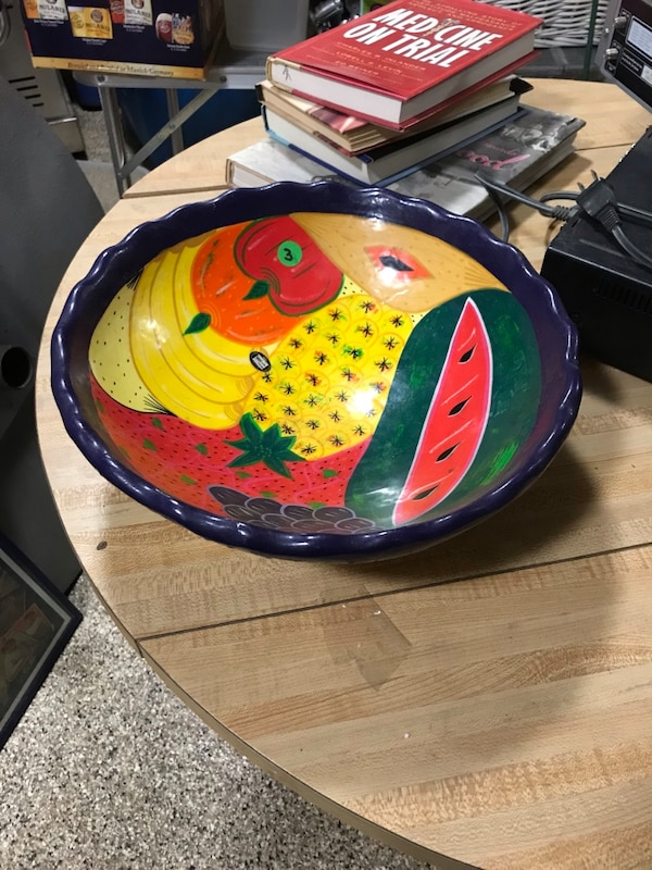 Yellow, blue, and green ceramic fruit bowl