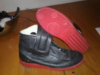 pair of black-and-red leather high-top sneakers London