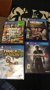 Four Sony PS4 game cases null, R0C