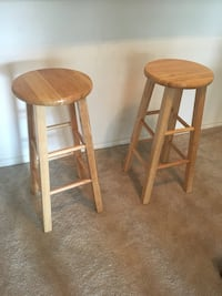 two brown wooden bar stools 23 mi