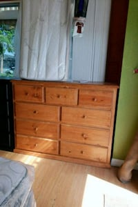 brown wooden dresser with mirror