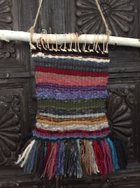multicolored woven wall hanging decor