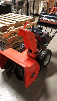 red and black Ariens ST824 snow blower