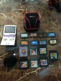 red Nintendo DS with game cartridges Fort Campbell, 42223