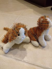 two brown and white animal plush toys