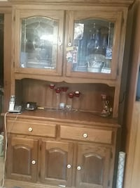 brown wooden framed glass display cabinet Regina, Saskatchewan, S4R 0B4