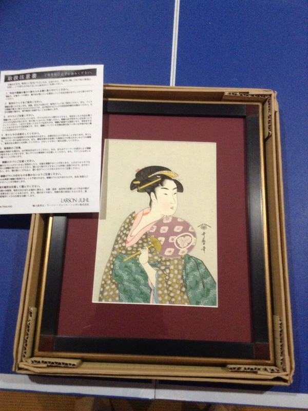 geisha painting with black frame in box