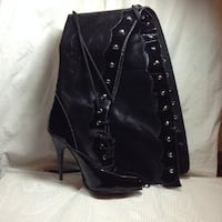 Paired black leather stiletto THIGH high boot